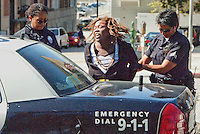 LAPD Officers arrest a woman at Bay Street  who allegedly stole a Buick LeSabre  on Friday, March 25, 2011. Police found the car via LoJack