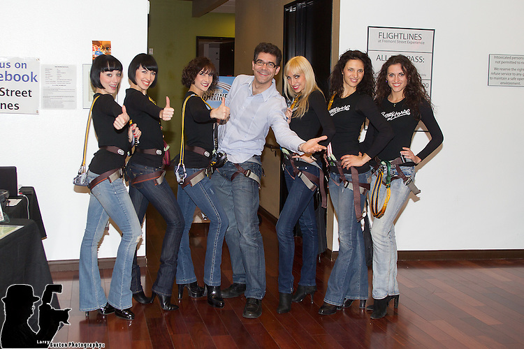 ... Crazy Horse Girls riding the zipline with Las Vegas newspaper editors