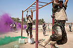 17th Iraqi Division soldiers scramble across a set of monkey bars on an obstacle course during a training exercise August 30, 2010 at the Joint Security Station (JSS) Deason in Mahmoudiyah, Iraq.