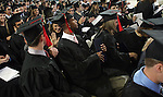 Drake University graduates enjoy their day at commencement exercises in 2005...The private University in Des Moines, Ia., has been lauded for it's outstanding programs in the arts in addition to having one of the best law schools and pharmacy departments in the country. Drake University,Des Moines,Iowa,graduation,commencement,scholar,diploma,tassle,cap,gown,celebration,achievement,education,career,commitment,family,pride, graduation,commencement,Drake Unversity,Des Moines,Iowa,pride,achievement,diploma,tassle,cap,gown,family,pride,joy,education,career,handshake,