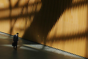 Japanese business man walks through the International Exhibition Forum, in Yurakacho district of Tokyo, Japan.
