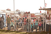 October 20, 2012. Raleigh, North Carolina.. Race fans try to get a view of the figure eight races, which cost an extra $9.00 over Fair admission to see. . 2012 North Carolina State Fair.