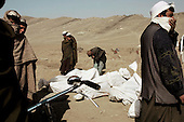 Kabul, Afghanistan<br /> November 21, 2001<br /> <br /> Dead foreign Taliban are lined up for burial in a cemetery outside of Kabul. They are each given a number, which was recorded in a photo with the body, and labeled by that number at burial for identification.