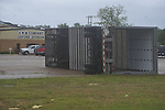 A trailer sits overturned in the SWM parking lot  as a result of a storm in the Lafayette County Industrial Park in Oxford, Miss. on Wednesday, April 27, 2011.