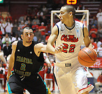"Mississippi's Marshall Henderson (22) drives past Coastal Carolina's Anthony Raffa (2) at the C.M. ""Tad"" Smith Coliseum in Oxford, Miss. on Tuesday, November 13, 2012. Henderson led all scorers with 27 points in Mississippi's 90-72 win. (AP Photo/Oxford Eagle, Bruce Newman)"