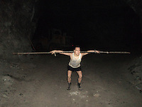 Pictures taken inside the San Jose mine in Chile where 33 miners were trapped for 69 days. The pictures were taken by and of Edison Pena before the miners were rescued. Edison Pena went on to become the 12th miner to be freed and the first to return home from hospital...Edison Pena exercising.