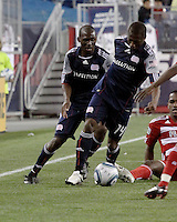 New England Revolution forward Kheli Dube (11) and New England Revolution midfielder Sainey Nyassi (14) retrieve the ball from FC Dallas midfielder/forward Atiba Harris(16).  The New England Revolution drew FC Dallas 1-1, at Gillette Stadium on May 1, 2010