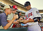 29 September 2012: Minnesota Twins infielder Jamey Carroll signs autographs prior to a game against the Detroit Tigers at Target Field in Minneapolis, MN. The Tigers defeated the Twins 6-4 in the second game of their 3-game series. Mandatory Credit: Ed Wolfstein Photo