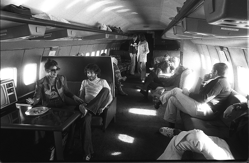 Led Zeppelin tour, 1975, including flying to L.A. on their private jet with all but Robert Plant. The tour was postponed while Plant healed from laryngitis, but he met the others on board upon their return.