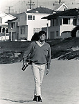 Photojournalist Ron Bennett walks on Manhattan Beach California,