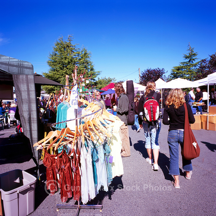 Artisans selling Clothing and Wares at the Saturday Market in Ganges, on Saltspring Island, in the Southern Gulf Islands of British Columbia, Canada