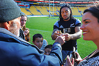 Ma'a Nonu signs photographer Peter Bush's gold bib during the All Blacks rugby captain's run at Westpac Stadium, Wellington, New Zealand on Friday, 12 September 2014. Photo: Dave Lintott / lintottphoto.co.nz