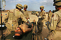 FALLUJAH, IRAQ - November 14: A wounded Jordanian Jihad fighter is treated by medics from the U.S. Army 1st Infantry Division 2-2 Task Force in Fallujah,Iraq November 14, 2004. The foreign fighter was wounded along with 2 other foreign fighters and one Iraqi while battling U.S. and Iraqi forces who have retaken the insurgent stronghold city of Fallujah over the past 6 days. Both American and Iraqi forces now claim to have regained complete control of the city although sporadic pockets of fierce resistance remain in some southern areas of the city.