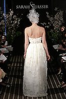 Model walks runway in an Enchanted wedding dress by Sarah Jassir, for the Sarah Jassir Fall 2011 - Desire bridal collection.