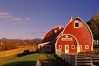 Red barn with view of mountains