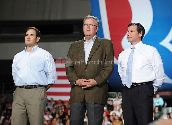 CORAL GABLES FL- OCTOBER 31:  Republican presidential candidate, former Massachusetts Gov. Mitt Romney speaks as Sen. Marco Rubio (R-FL), former Florida Gov. Jeb Bush and U.S. Representative Connie Mack attend a camapign rally at the University of Miami on October 31, 2012 in in Coral Gables, Florida. (Photo By Larry Marano (C) ***NO GERMANY***NO AUSTRIA***