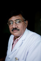 Dr. Suresh Dwivedi, Chief Medical Superintendent (CMS) of the Allahabad District, poses for a portrait in his office in Allahabad, Uttar Pradesh, India. Photo by Suzanne Lee / Panos London