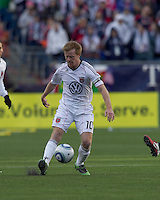 DC United midfielder Dax McCarty (10) passes the ball. In a Major League Soccer (MLS) match, the New England Revolution defeated DC United, 2-1, at Gillette Stadium on March 26, 2011.