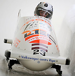 15 December 2007: Latvia 1 pilot Aiva Aparjode, with Janika Dzeguze on the brakes, exit turn 19 during their first run of the FIBT World Cup Bobsled Competition at the Olympic Sports Complex on Mount Van Hoevenberg, at Lake Placid, New York, USA. ..Mandatory Photo Credit: Ed Wolfstein Photo