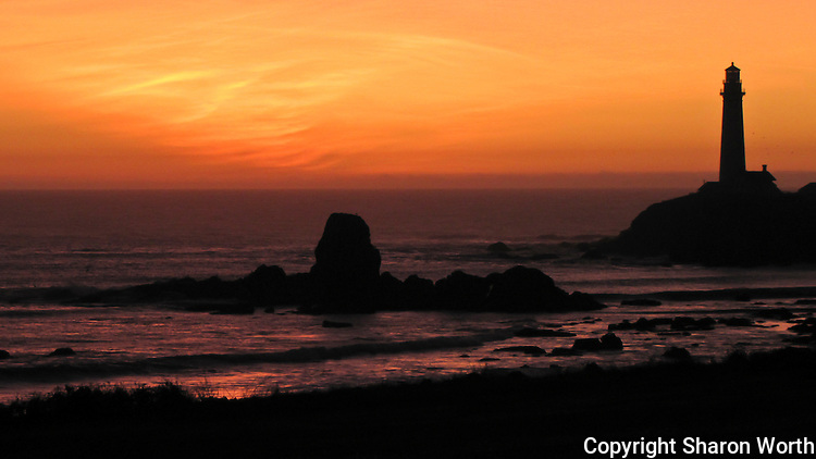 """From the California State Parks Department, """"The rocky island in the middle of the cove is called """"Prisoner Rock"""" because fishermen were often stranded on it when high tides cut off their return to shore. """"  A Winter sunset at Pigeon Point Light Station."""