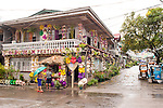 This house had finished decorating with buri well before the home decoration contest.  Fortunately, it looks like the overhanging eaves mostly protected its buri decorations from the rain. (Sampaloc, Quezon Province, the Philippines)