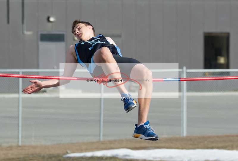 7589 <br /> Chugiak&rsquo;s Jared Parks makes an attempt at the 5&rsquo; 2&rdquo; high jump at West High Friday afternoon.  Photo for the Star by Michael Dinneen