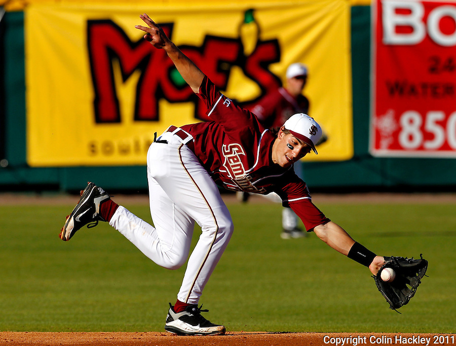 TALLAHASSEE, FL 2/18/11-FSU-VMI BASE11 CH-Florida State's Justin Gonzalez knocks down a grounder during first inning action against Virginia Military Institute Friday the Dick Howser Stadium in Tallahassee. The Seminoles beat the Keydets 12-0 in the season opener for both teams..COLIN HACKLEY PHOTO