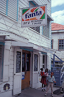 Belizian children outside Dit's Restuarant in downtown Belize City, Belize