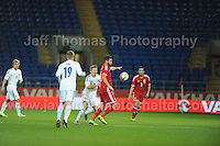 Joe Ledley of Wales is challenged by Riku Riski of Finland during the Wales v Finland Vauxhall International friendly football match at the Cardiff City stadium, Cardiff, Wales. Photographer - Jeff Thomas Photography.  Mob 07837 386244. All use of pictures are chargeable.