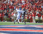 Ole Miss quarterback Jeremiah Masoli (8) outruns Kentucky's Dakotah Tyler (28) to score a touchdown at Vaught-Hemingway Stadium in Oxford, Miss. on Saturday, October 2, 2010. Ole Miss won 42-35 to improve to 3-2..