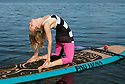 PE00292-00...WASHINGTON - Carly Hayden doing paddle board yoga in the Puget Sound at Brackett's Landing North, Edmonds.  (MR #H13)