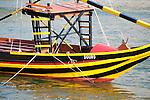 Colorful port wine boat, named Douro, on the Douro River in Porto, Portugal.