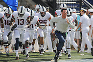 Annapolis, MD - September 9, 2016: Connecticut Huskies head coach Bob Diaco runs out during game between UConn and Navy at  Navy-Marine Corps Memorial Stadium in Annapolis, MD. September 9, 2016.  (Photo by Elliott Brown/Media Images International)
