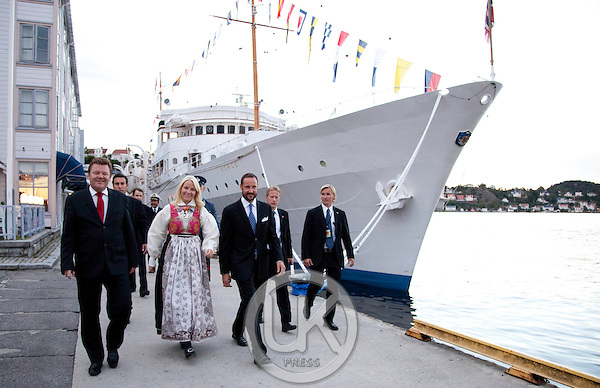 """Crown Prince Haakon and Crown Princess Mette-Marit of Norway leave the Royal Yacht, """" Norge """" to attend a dinner at Arendal town hall  during a  three day visit, to the county of Aust-Agder in Southern Norway.."""