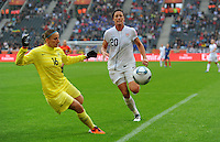 Abby Wambach (r) of team USA and Berangere Sapowicz of team France during the FIFA Women's World Cup at the FIFA Stadium in Moenchengladbach, Germany on July 13th, 2011.