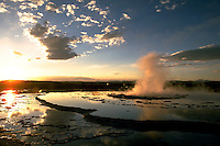 Great Fountain Geyser, spouting, at sunset, Yellowstone National Park. Wyoming, Yellowstone National Park.