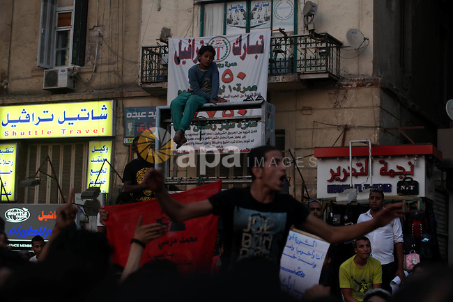 Egyptian protesters take part in a demonstration at Tahrir square in Cairo June 14, 2012. Egypt's supreme court ruled on Thursday to dissolve the Islamist-led parliament, plunging a troubled transition to democracy into turmoil just two days before an election to replace ousted leader Hosni Mubarak. Photo by Majdi Fathi