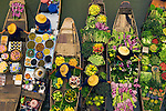 Floating markets are a common tradition throughout Southeast Asia where the numerous rivers and waterways are a primary means of transportation and commerce between villages. In this overhead view, Bangkok vendors draw their boats together to exchange a colorful, tasty array of goods, Thailand.