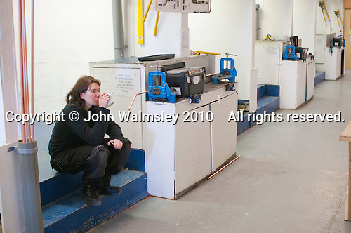 Plumbing student taking a break, Able Skills, Dartford, Kent.