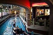 Tourists take ride of the Gondola inside the shopping centre of The Venetian Macau Resort Hotel in Macau, China.
