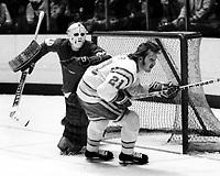 Seals #21 Stan Weir and Detroit goalie Terry Richardson, (1975 photo/Ron Riesterer)