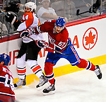 7 December 2009: Montreal Canadiens' left wing forward Max Pacioretty checks Philadelphia Flyers defenseman Kimmo Timonen into the boards at the Bell Centre in Montreal, Quebec, Canada. The Canadiens defeated the Flyers 3-1. Mandatory Credit: Ed Wolfstein Photo
