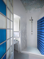 An open shower area has been created in a small vaulted room in the former convent