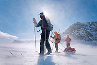 Saltoluokta Mountain Station, Jokkmokk, Lapland, Sweden, March 2013. Extreme winds cause a blinding blizzard with a windchill factor of close to -40C. Arctic survival training and winter bushcraft  in the frigid mountains of the Stora Sjofallet National Park and Sarek National Park with mountain guide Claes Jorgen Pohl.  Dressed in an orange 1980's anorak, Sami native Rolf Rimpi joins our tour on traditional wooden skis and poles. Photo by Frits Meyst/Adventure4ever.com
