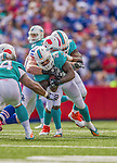 14 September 2014: Miami Dolphins running back Lamar Miller is taken down short of a first down against the Buffalo Bills in the fourth quarter at Ralph Wilson Stadium in Orchard Park, NY. The Bills defeated the Dolphins 29-10 to win their home opener and start the season with a 2-0 record. Mandatory Credit: Ed Wolfstein Photo *** RAW (NEF) Image File Available ***