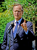 United States President George H.W. Bush answers questions concerning his involvement in the Iran/Contra Affair at the departure ceremony for Prime Minister Brian Mulroney of Canada at the White House in Washington, D.C. on May 5, 1989.<br /> Credit: Arnie Sachs / CNP