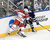Vincent LoVerde (Miami - 14), John Henrion (UNH - 16) - The University of New Hampshire Wildcats defeated the Miami University RedHawks 3-1 (EN) in their NCAA Northeast Regional Semi-Final on Saturday, March 26, 2011, at Verizon Wireless Arena in Manchester, New Hampshire.