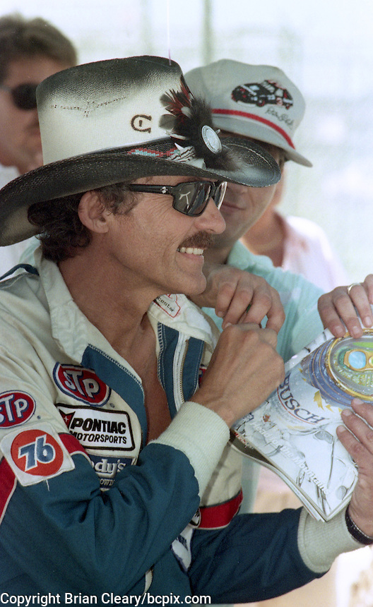 Richard Petty signs autographs before the Pepsi 400 at Daytona International Speedway, Daytona Beach, FL, July 7, 1990 (Photo by Brian Cleary/www.bcpix.com)