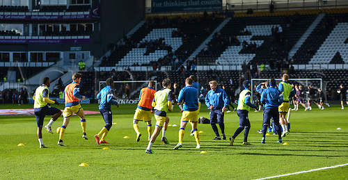 21.2.2015.  Derby, England. Skybet Championship. Derby County versus Sheffield Wednesday. Sheffield Wednesday warm up on the pitch ahead of the match.