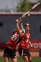Brittany Poist (27) of Maryland tries to take control of a loose ball during the ACC women's lacrosse tournament finals in College Park, MD.  Maryland defeated North Carolina, 10-5.